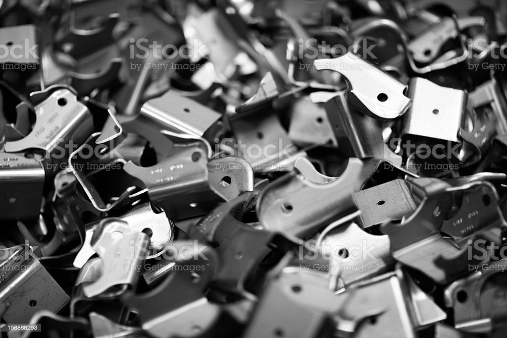 Black and white photo of a pile of metal parts royalty-free stock photo