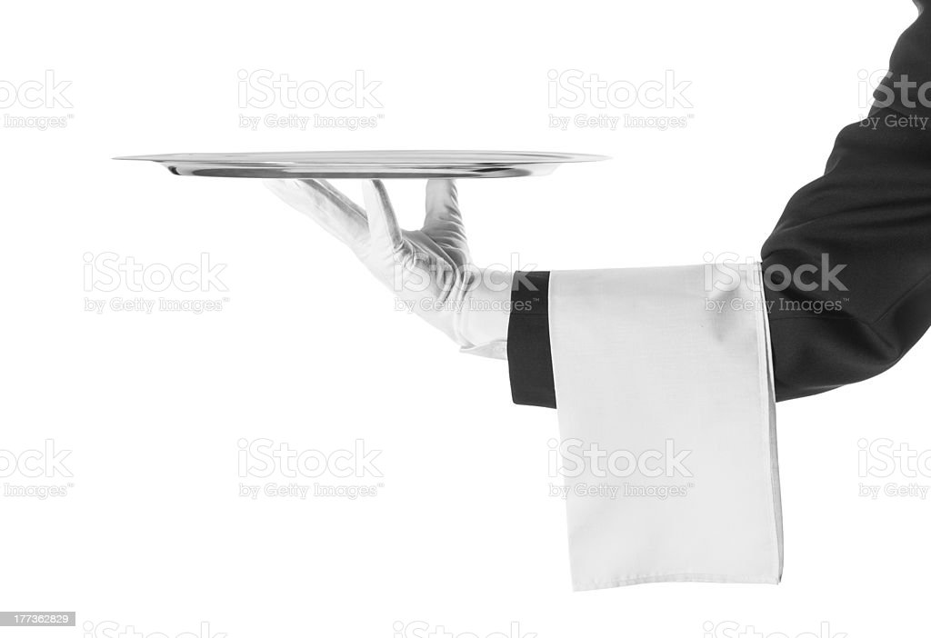 A black and white photo of a waiter holding a platter stock photo