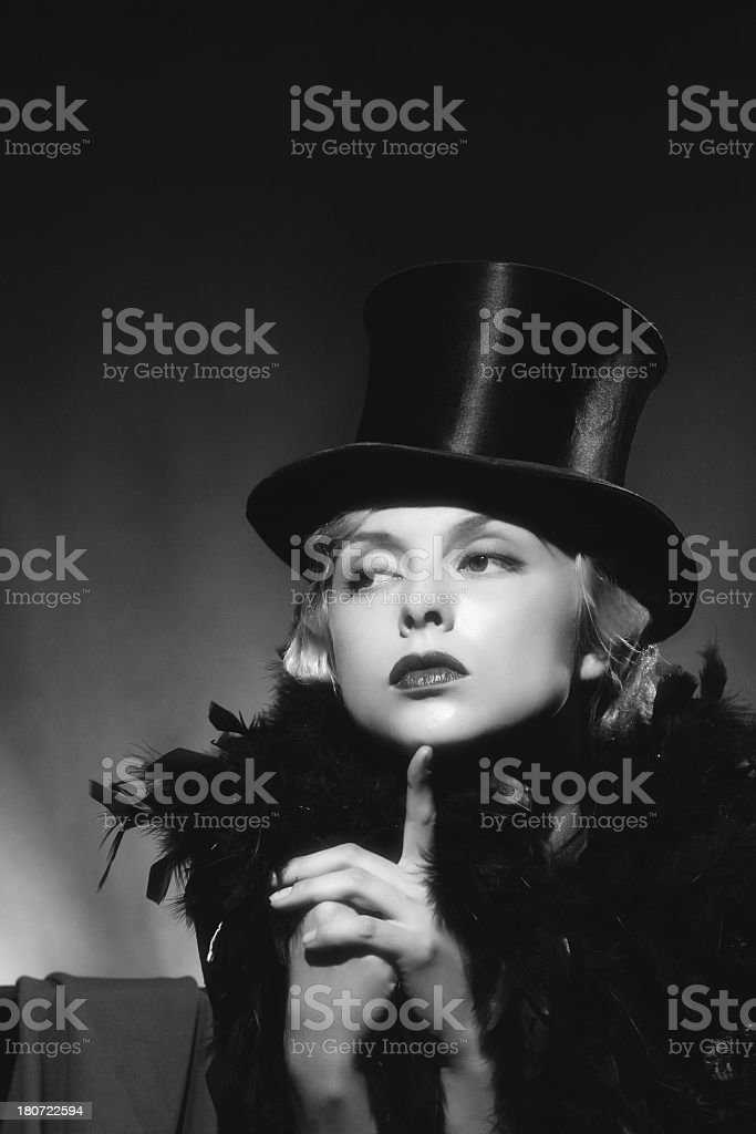 Black and white photo of a woman in a 1940s top hot royalty-free stock photo