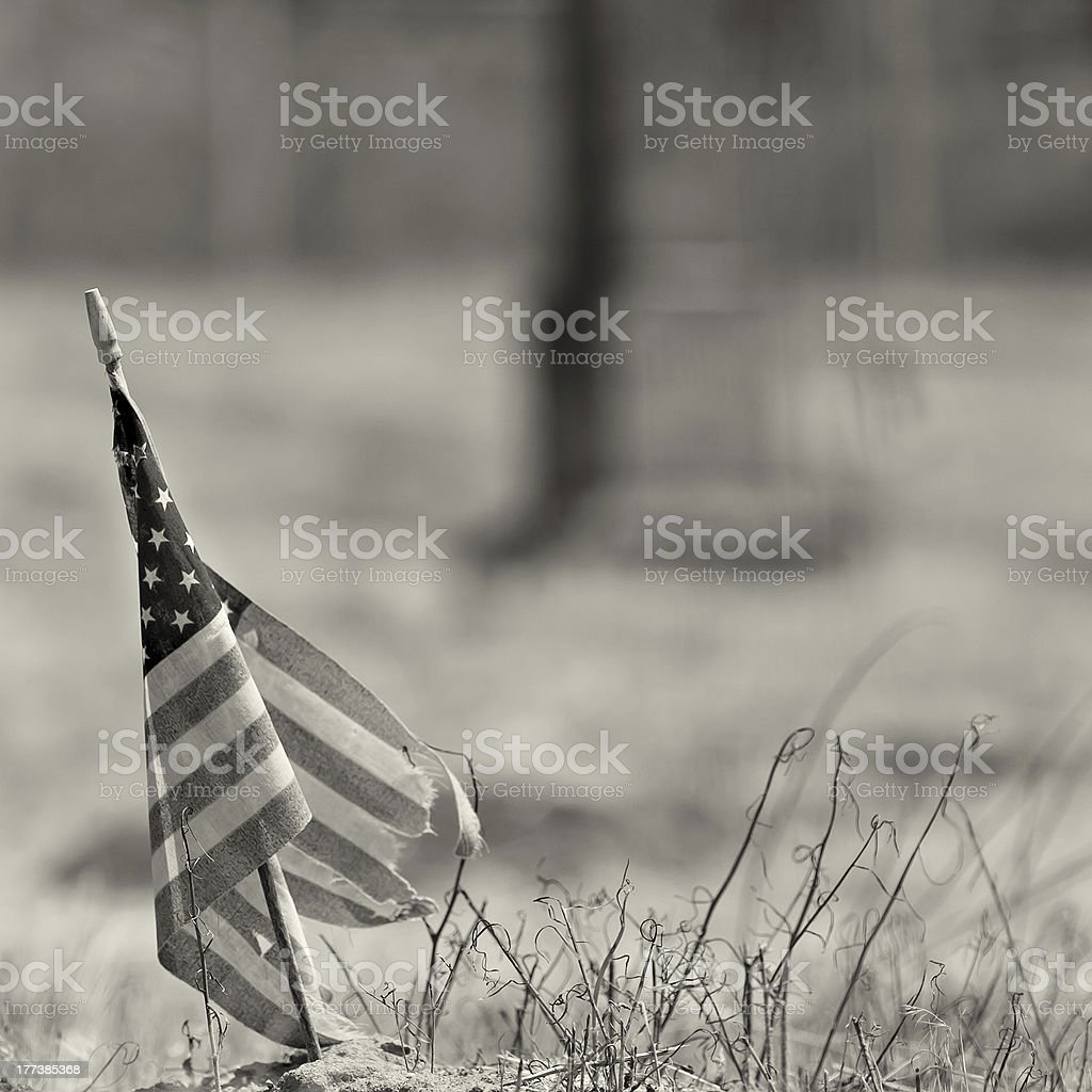 Black and white photo of a worn out american flag stock photo