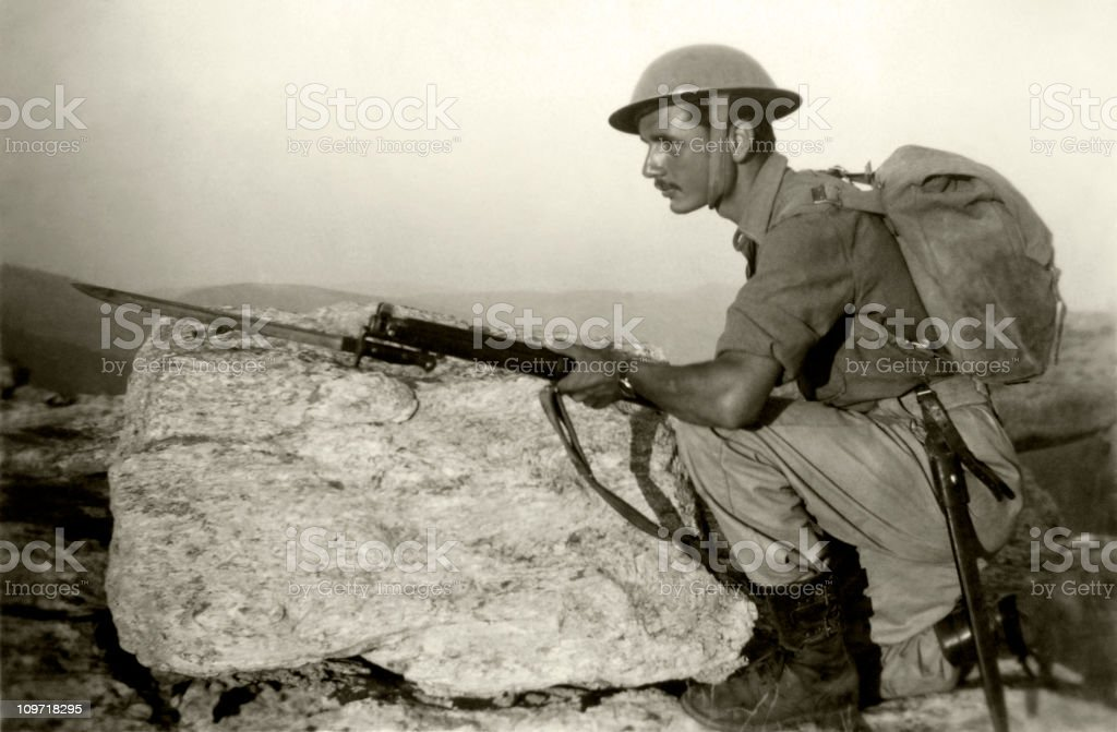 A black and white photo of an armed soldier stock photo