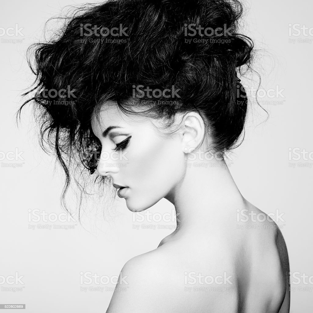 Black and white photo of beautiful woman with magnificent hair stock photo
