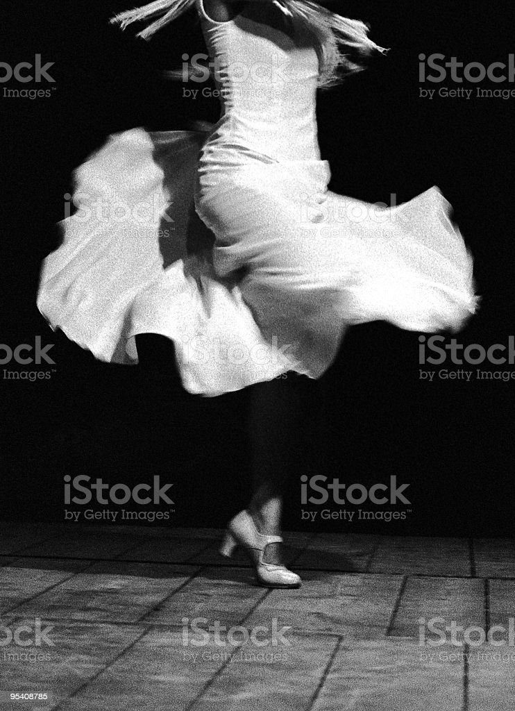 Black and white photo of flamenco dancer's swinging skirt royalty-free stock photo