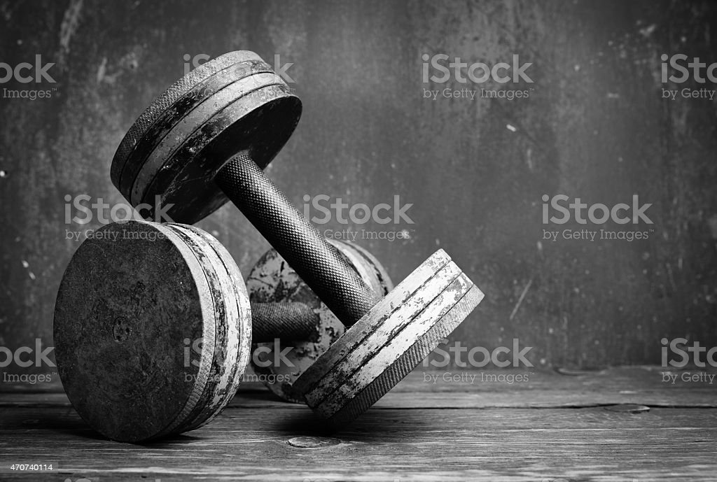 A black and white photo of old dumbbells stock photo