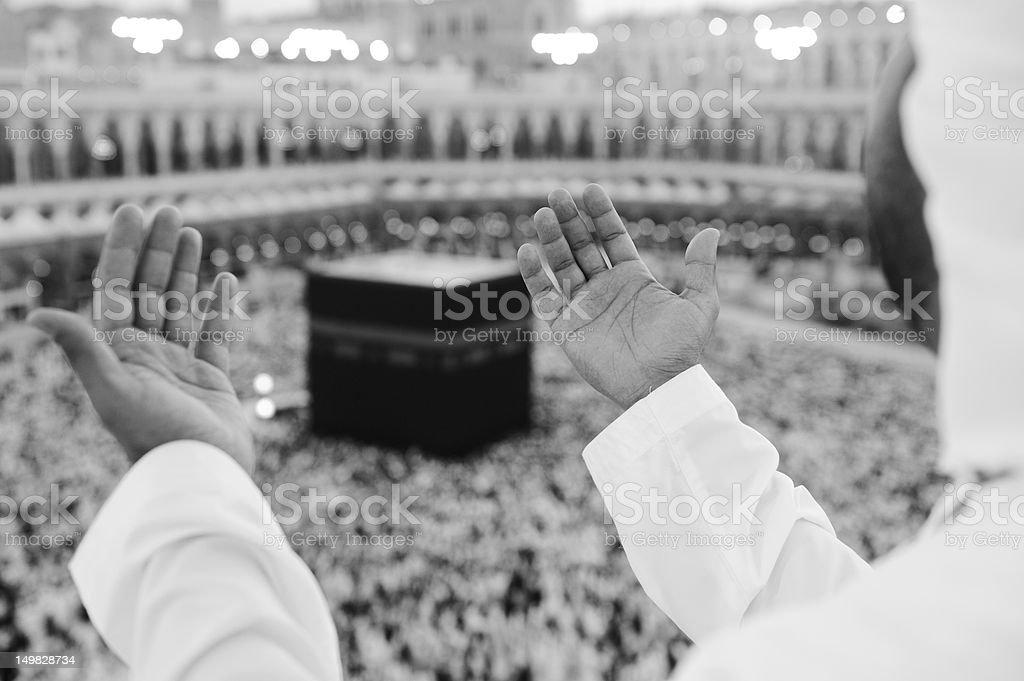 Black and white photo of religious man praying at Makkah stock photo