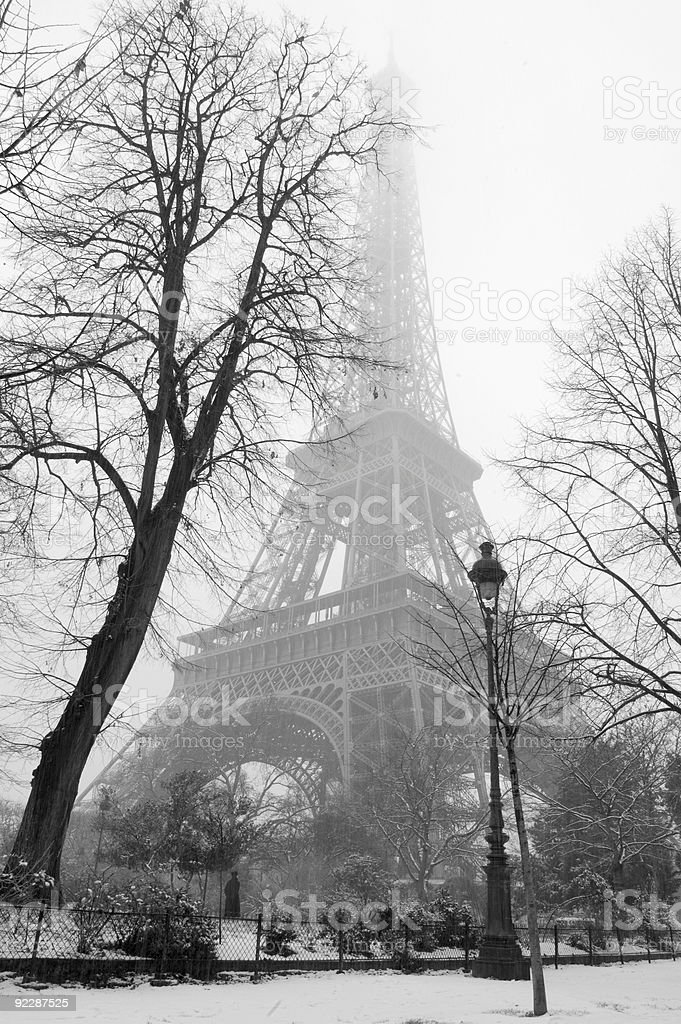 Black and white photo of the Eiffel Tower during snow stock photo