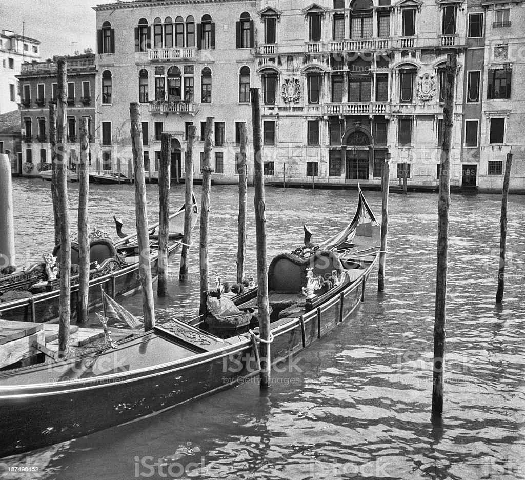 Black and white photo of Two gondolas moored, Canal Grande stock photo