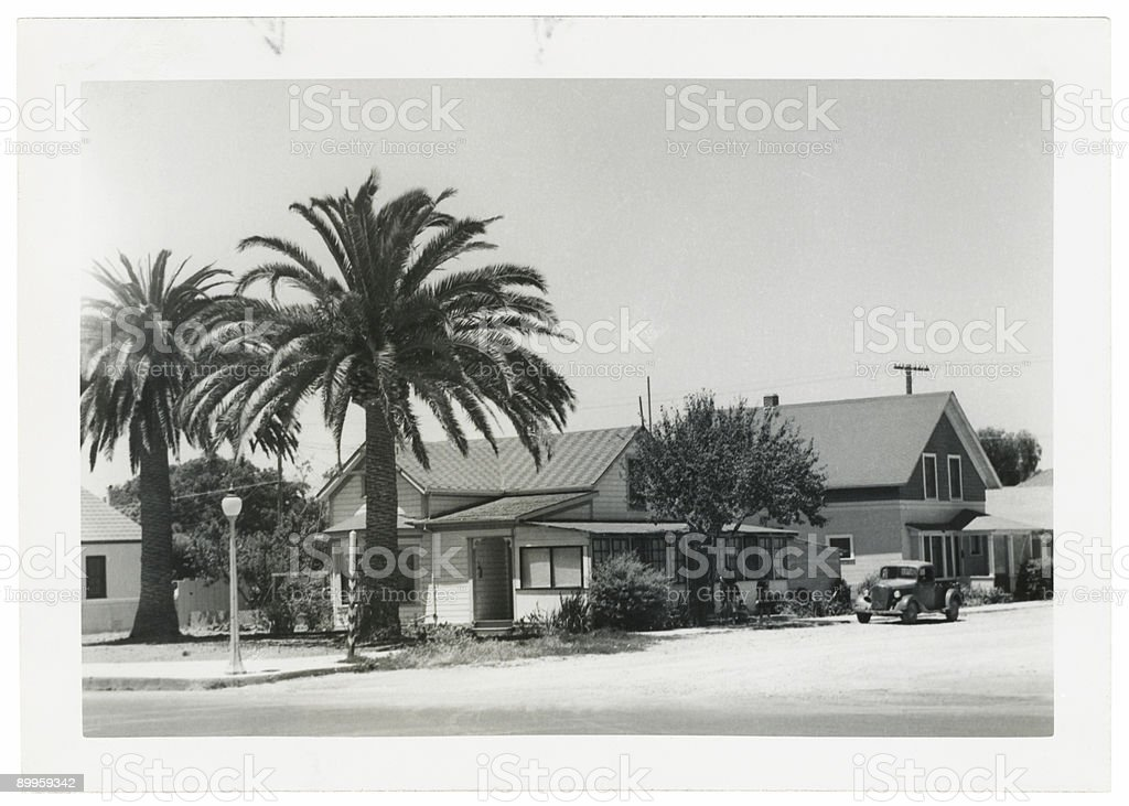 Black and White Photo Retro House with Palm Trees stock photo