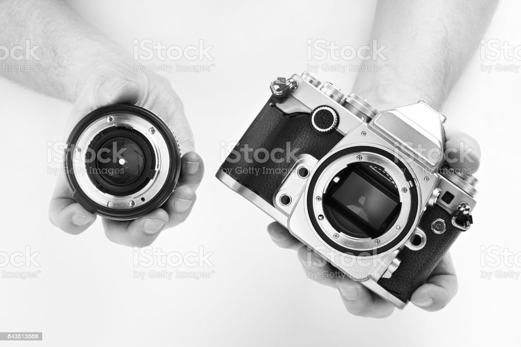 Black and white photo SLR camera in hands photographer stock photo