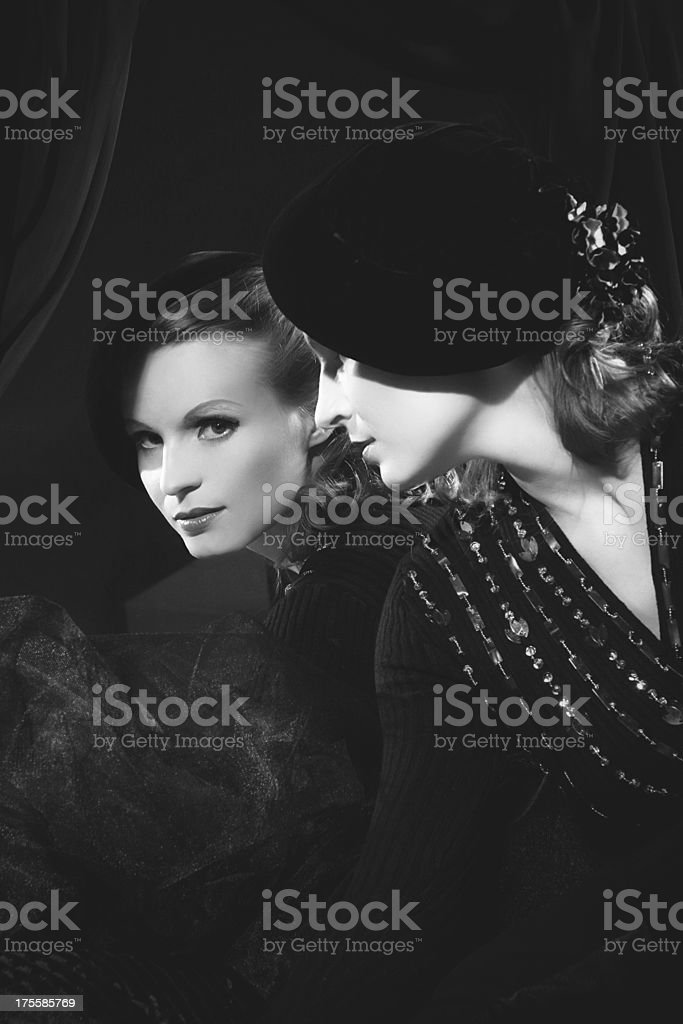 Black and white photograph of woman looking in the mirror stock photo