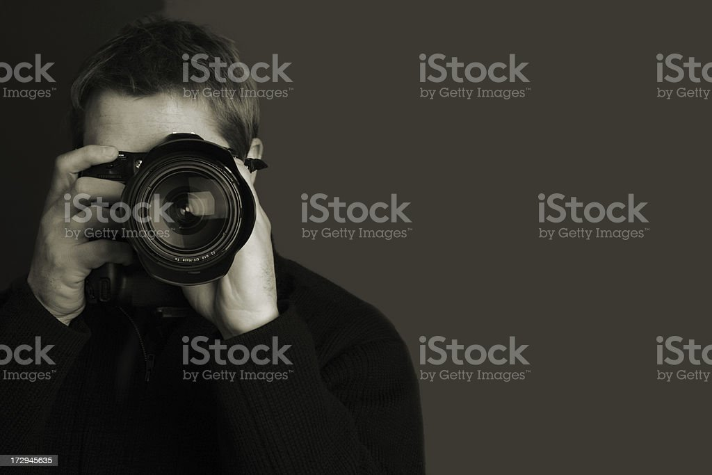 Black and white photographer taking a picture stock photo
