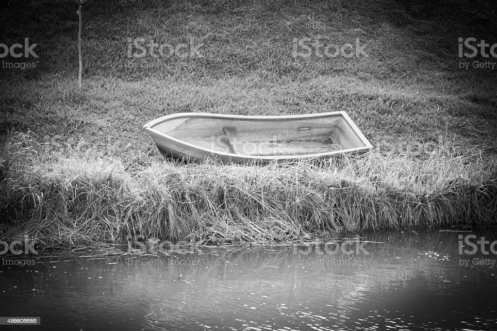 black and white photography of boat stock photo