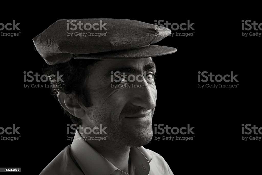 Black and white photos of a man wearing an eight bent style hat. stock photo