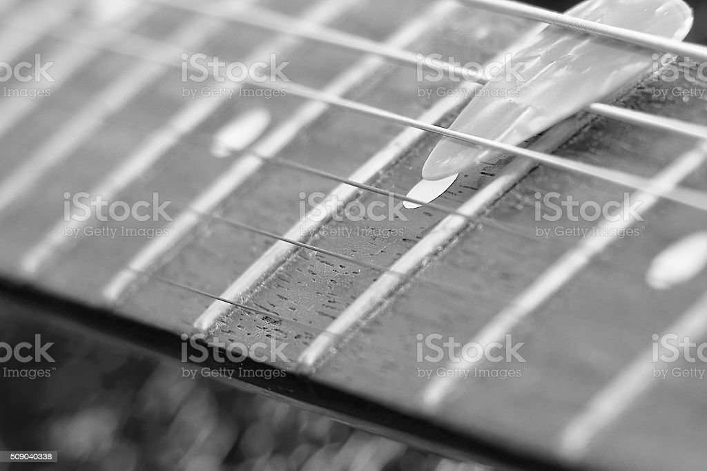 black and white pick and vintage electric guitar stock photo