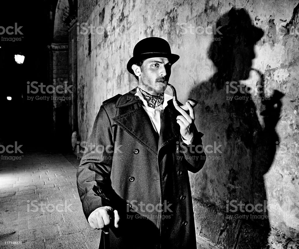 Black and white picture of a detective smoking his pipe stock photo