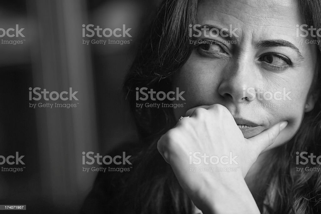A black and white picture of a distrustful woman stock photo