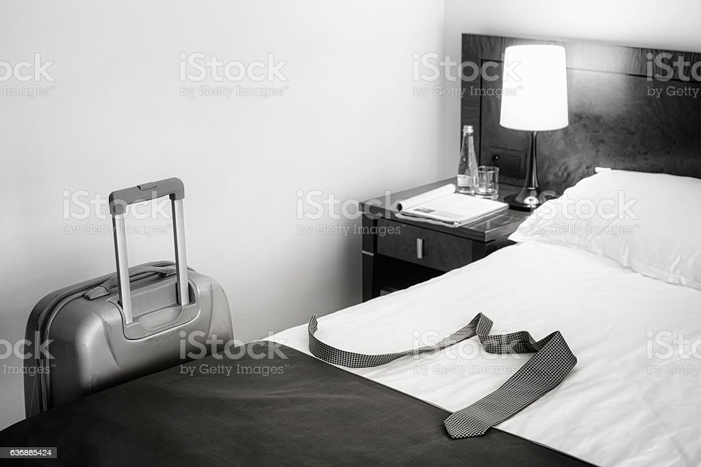 Black and white picture of a tie on bed. stock photo