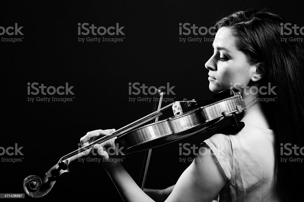 Black and white picture of a woman playing violin  stock photo