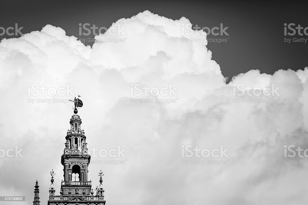 Black and white picture of La Giralda in Sevilha with clouds stock photo