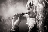 Black and white picture of woman smoking e-cigarette