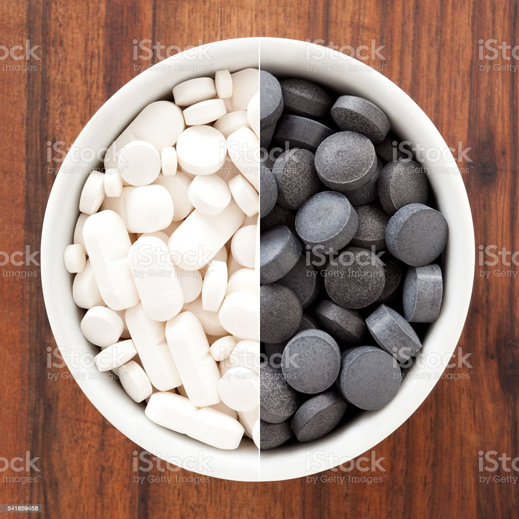 Black and white pills composition stock photo