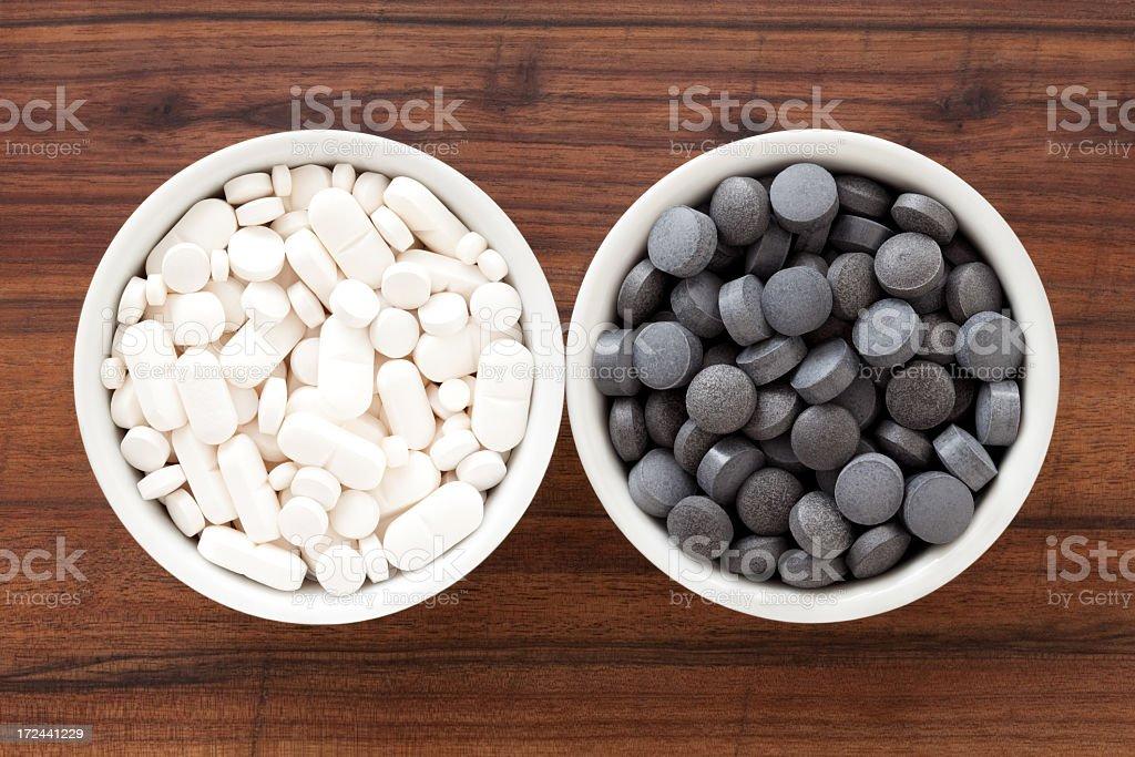 Black and white pills royalty-free stock photo