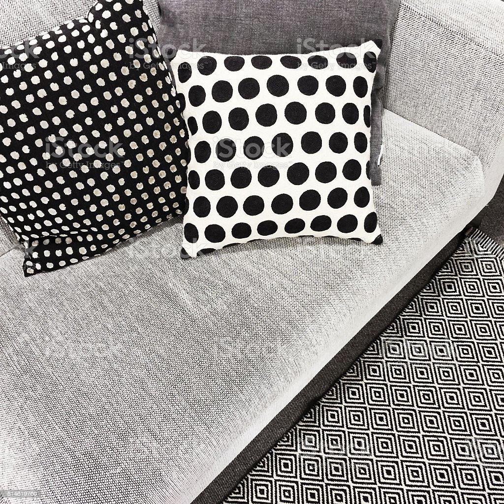 Black and white polka dot cushions on a sofa stock photo