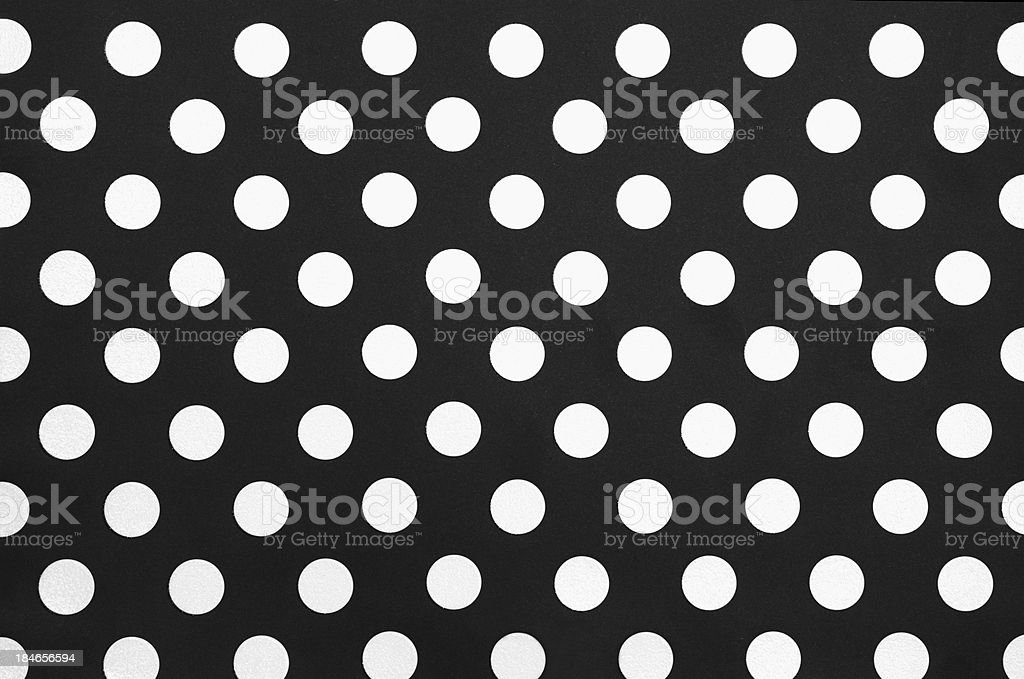 Black and white polka dotted paper background stock photo