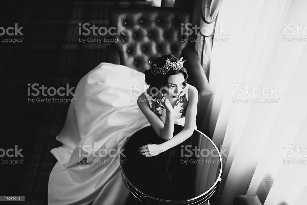 Black and white portrait of a bride sitting at a table stock photo