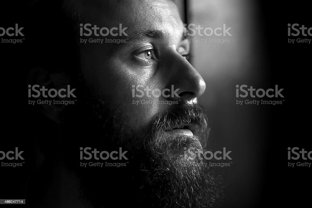 Black and white portrait of a serious man, side view stock photo