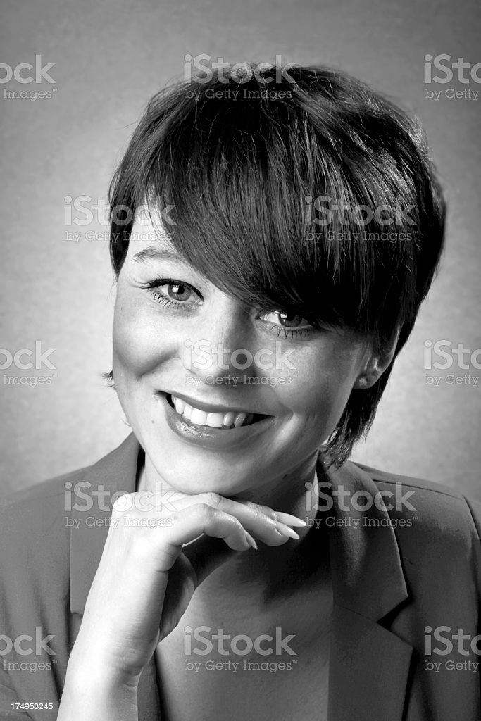 Black and white portrait of a smiling young woman royalty-free stock photo