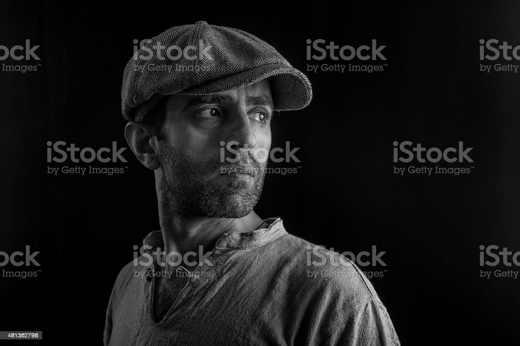 Black And White Portrait Of Adult Man Wearing Newsboy Cap stock photo