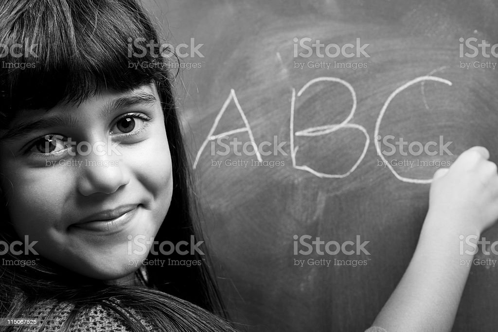 Black And White Portrait Of Little Girl Learning Alphabet royalty-free stock photo