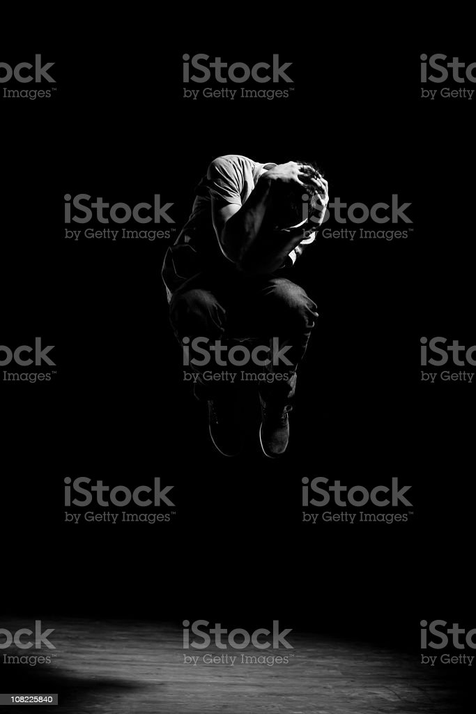Black and White Portrait of Male Dancer in Mid-Air stock photo