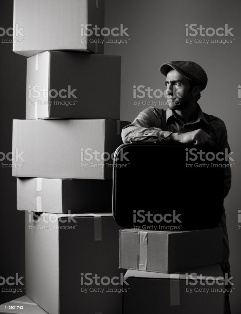 Black and white portrait of man packing home for relocation stock photo