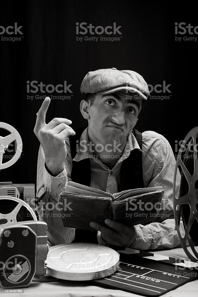 Black And White Portrait Of Man Reading Script For Practicing stock photo