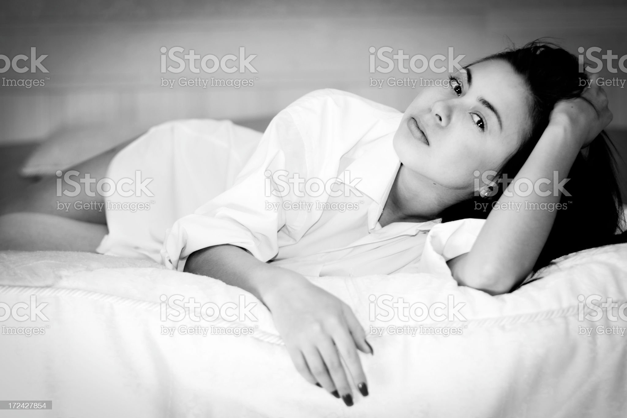 Black and white portrait of woman in bedroom royalty-free stock photo