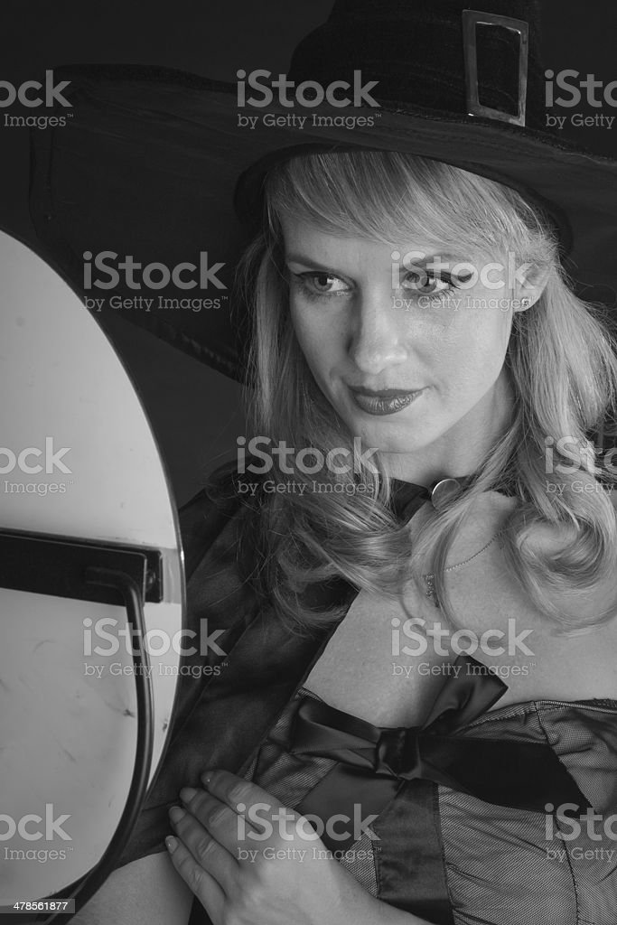 black and white portrait of woman  looks in mirror and smiling royalty-free stock photo