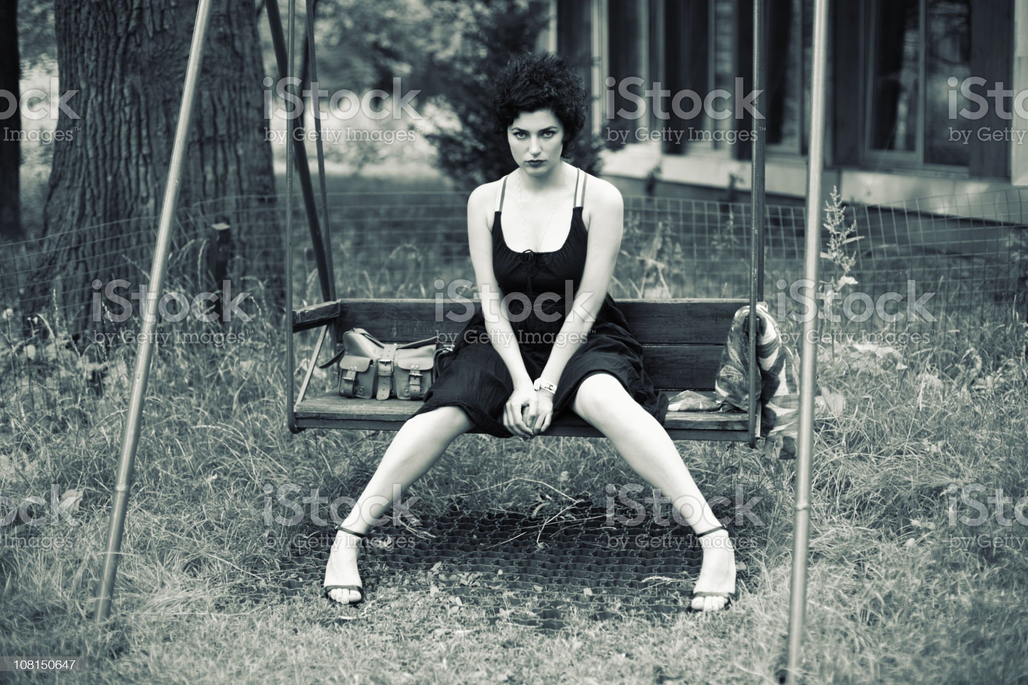 Black and White Portrait of Woman Sitting on Day Swing royalty-free stock photo