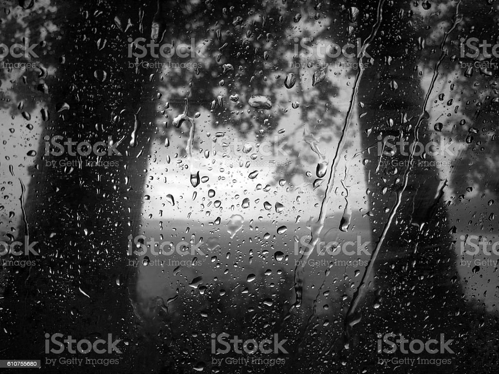 Black and white raindrops on the glass, dramatic storm clouds stock photo