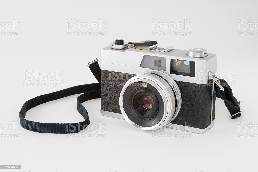 Black and white rangefinder camera on a white surface stock photo