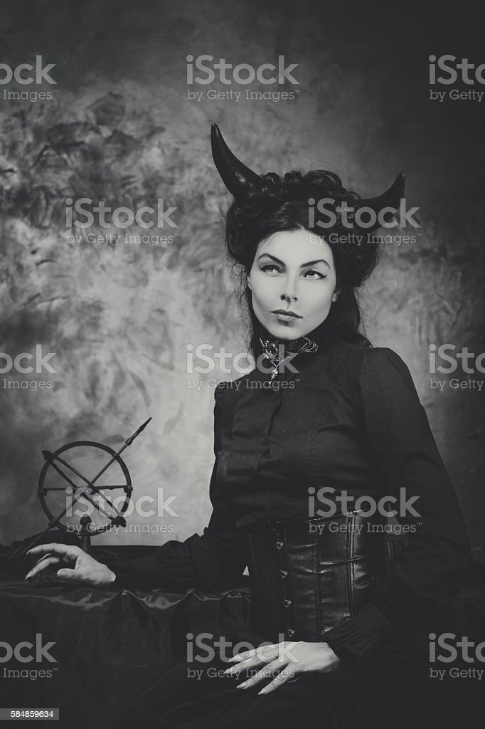 Black and white retro photo, woman demon, devil. Girl with stock photo