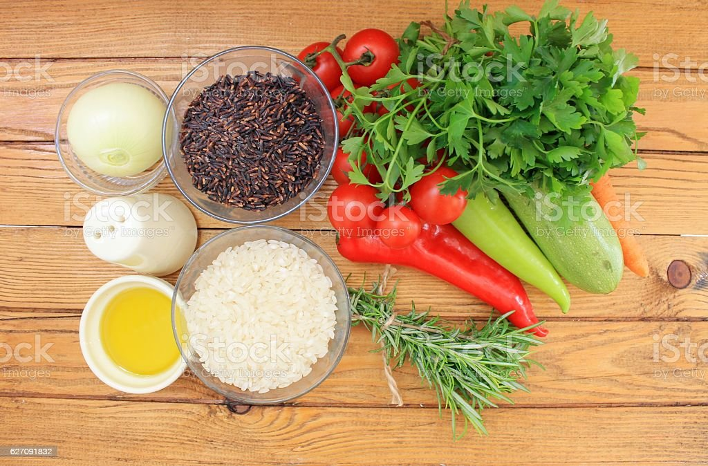 Black and white rice with vegetables stock photo