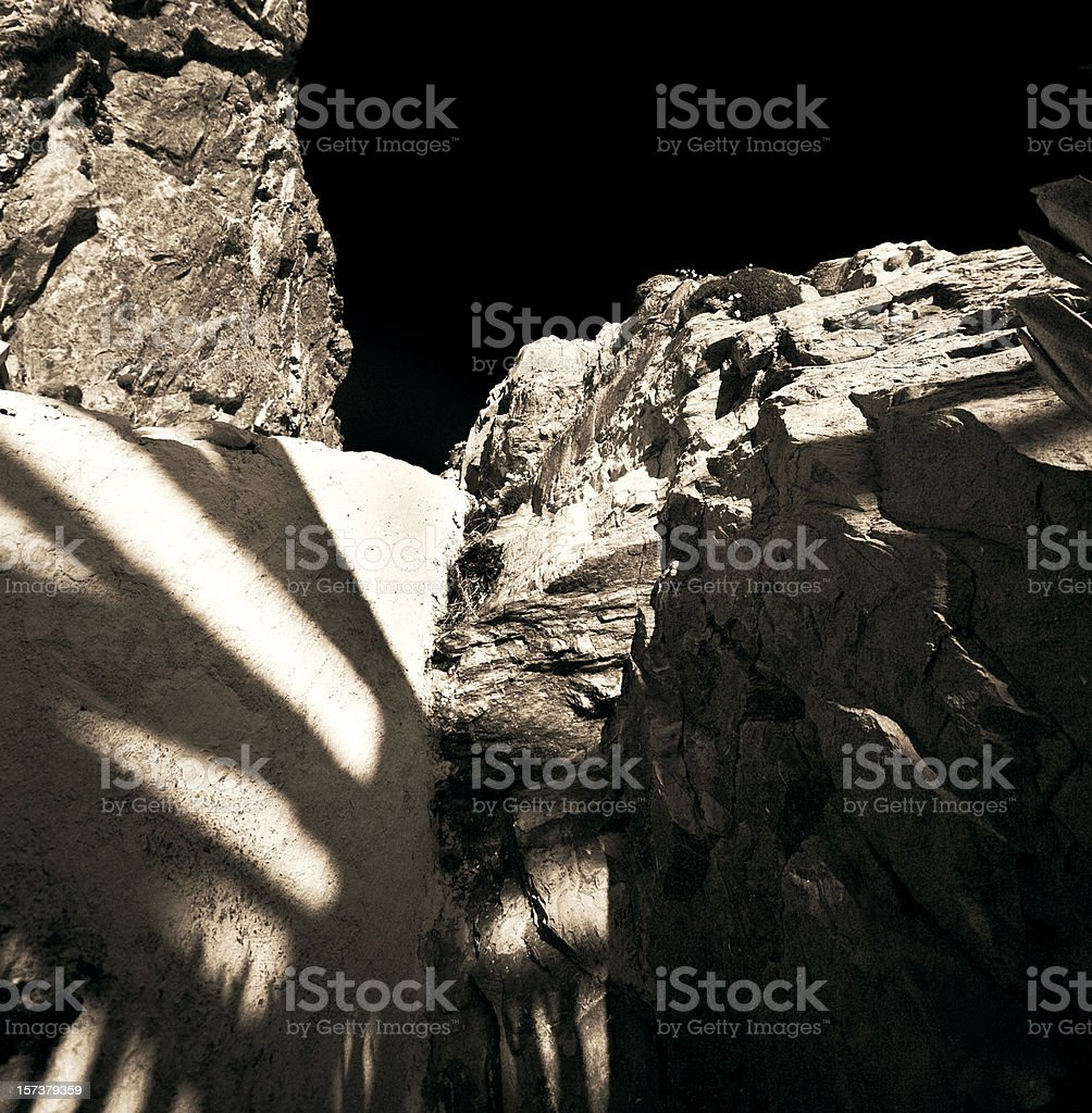 Black and White Rock Formation against Sky stock photo