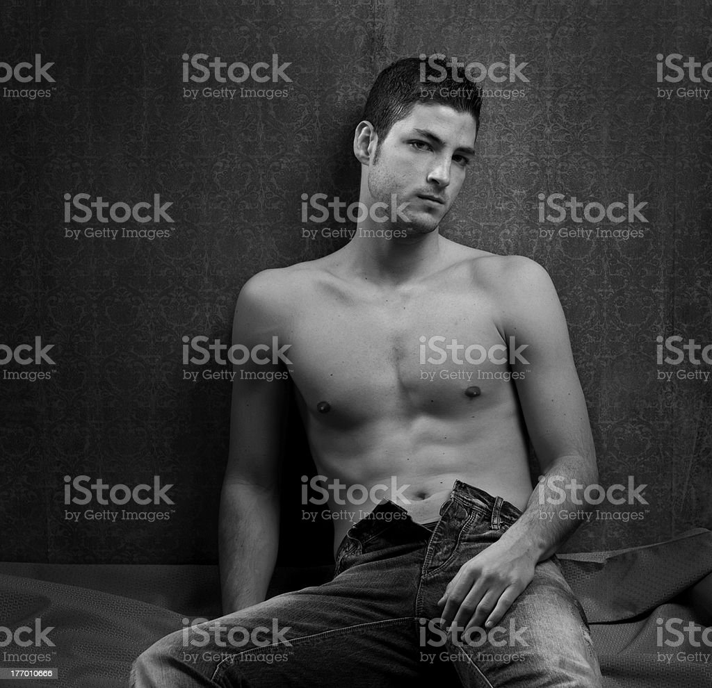 Black and white sexy young shirtless man royalty-free stock photo