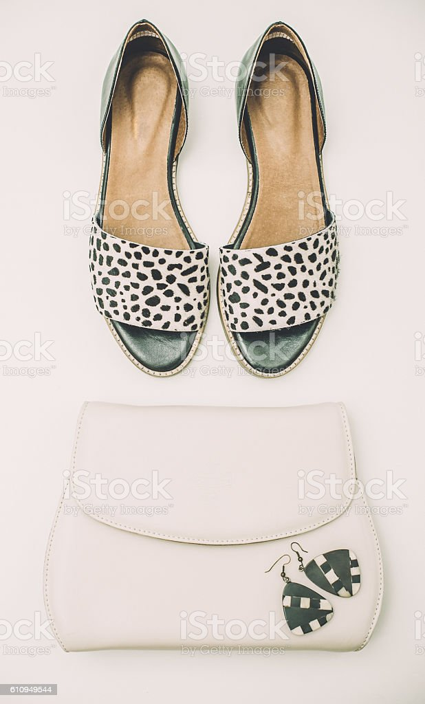 Black and white shoes, purse and earrings stock photo