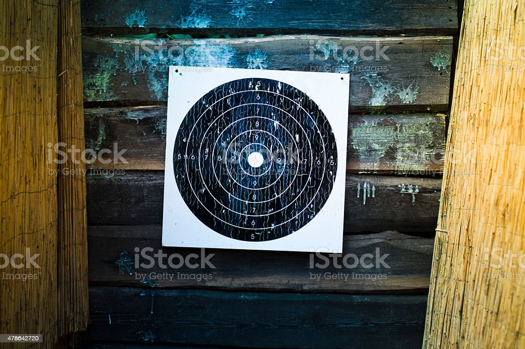 Black and white shooting shield at a wooden wall stock photo
