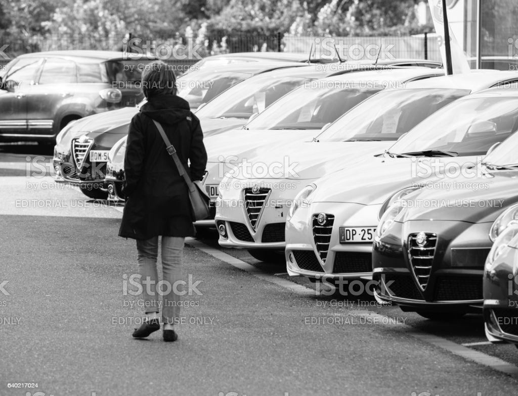 Black and white Shopping new car woman choosing car row stock photo