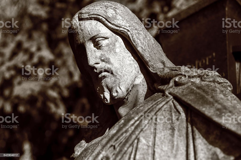 black and white shot of a jesus sculpture stock photo