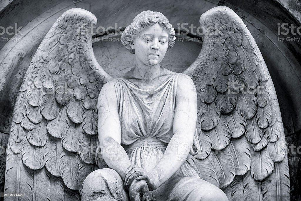 black and white shot of an angel. stock photo